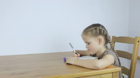 Girl learning and writing assignments
