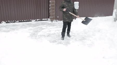 Man cleaning the road from the snow