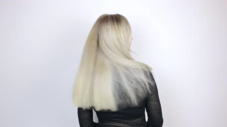 The girl shows off her dyed blonde hair