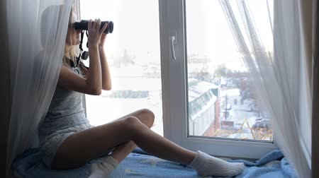 мониторинг : Girl watching through binoculars