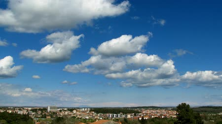 orbe : Clouds forming and passing on the blue sky over a nice landscape.