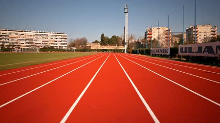 stopa : Shot of the stadiumathletic track fro the runners perpsective.