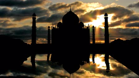 hűség : Famous Taj Mahal with the clouds passing over the sky.