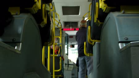 koç : People entering riding and exiting from the bus public transportation.