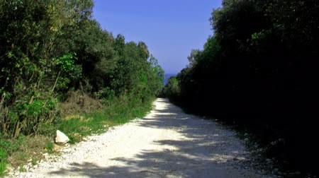 macadam : Going on a dusty white road towards the sea. Stock Footage