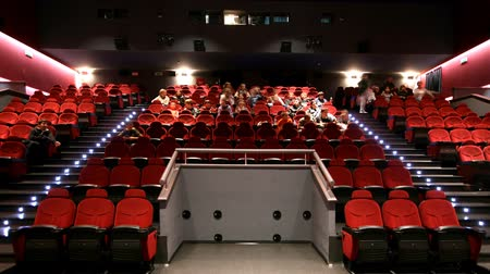 aisles : People taking their seats in the movie theatre. Stock Footage