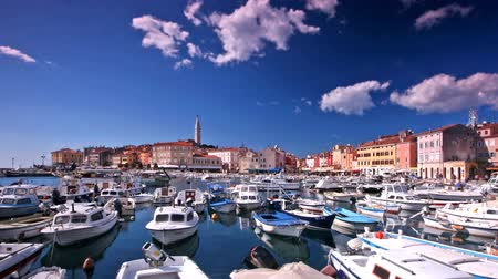 trave : Port in Rovinj with fishing boats view to the old part of the city and blue sky and clouds passing. Stock Footage