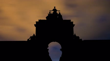 comercio : Arco da Rua Augusta is an arch located on Praca de Comercio square or the Commerce Square in Lisbon Portugal. The square is still commonly known as Terreiro do Paco or the Palace Square. Stock Footage