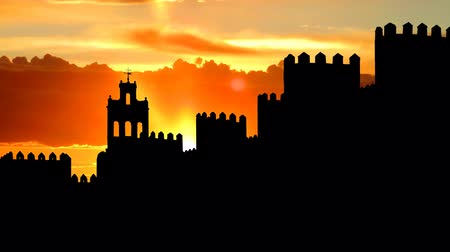 средневековый : Avila is a Spanish city famous for having a complete medieval city walls.