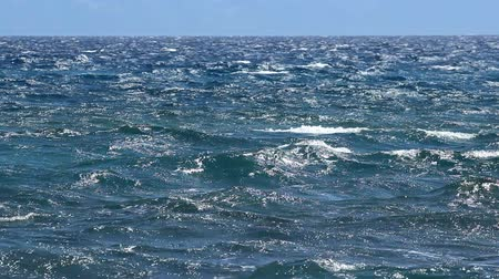 пена : Blue sea on the windy day.