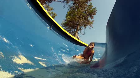 slayt : Girl having fun at the waterslide. Stok Video