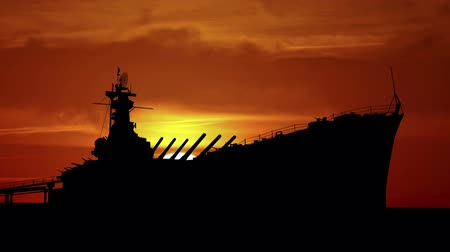 navio : Battleship during sunrise.