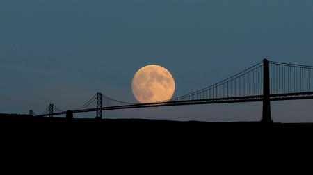 tower bridge : San Francisco bay bridge during moonrise.