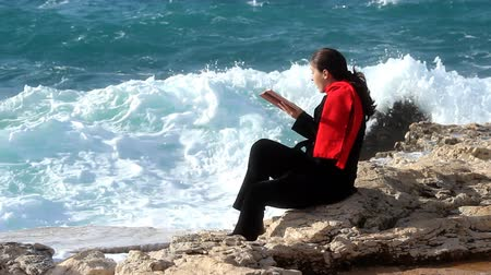 jump away : Woman reading and washed by the sea wave.
