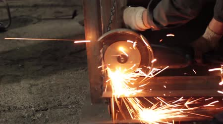 iron pipe : worker cuts metal sheets abrasive tool
