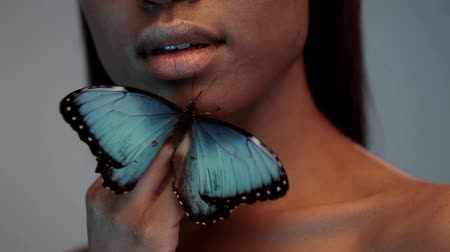afro amerikai : Young beautiful afro girl, with butterflies, beauty portrait