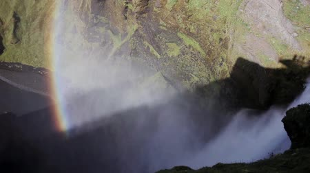 skogafoss : Iceland, view of Skogafoss waterfall, pan. View from the top Stock Footage