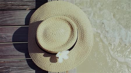 プルメリア : Still life with a hat On the background of clear blue sea water