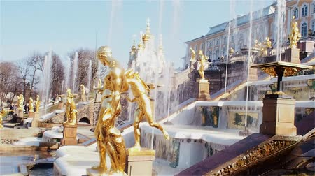 Golden sculptures of the main cascade of fountains in Peterhof, a suburb of St. Petersburg