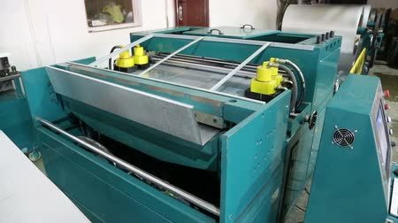 sheet : Machine with CNC for working with metal. Machine produces a duct made of tin. Stock Footage