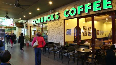 coffee : TANAH RATA, MALAYSIA - CIRCA FEBRUARY, 2015: Starbucks Coffee coffeehouses in Tanah Rata, Cameron Highlands. Starbucks Corporation coffee company has more 21500 coffeehouses around the world.