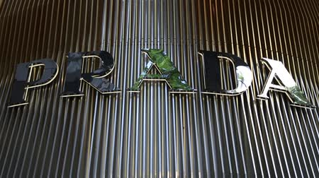 loga : SINGAPORE - CIRCA FEBRUARY, 2015: Prada Logo on the shopping center on Orchard Road in Singapore. Prada is an Italian fashion label specializing in luxury goods for men and women.