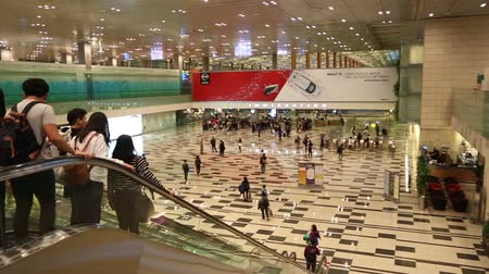 departure : SINGAPORE - JANUARY 26, 2015: Changi International Airport is a major aviation hub in Asia, serves more than 100 airlines operating 6,100 weekly flights connecting Singapore to over 220 cities. Stock Footage