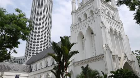 catholic cathedral : SINGAPORE - CIRCA JANUARY, 2015: Saint Andrews Cathedral is an Anglican cathedral in Singapore, countrys largest cathedral, was built from 1835 to 1836. Is located in the Central Area in Singapore Stock Footage