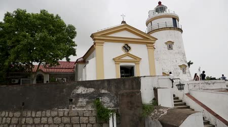 portugese : MACAO - CIRCA JUNE, 2014: Guia Fortress and Lighthouse with views residential areas Macao. Macao is a major tourist destination and annually receives about 30 million tourists from around the world.