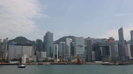 Виктория : HONG KONG  CIRCA JUNE 2014: View of the Hong Kong Convention and Exhibition Centre. In the strait of very heavy traffic of ferries cruise ships and ocean liners.