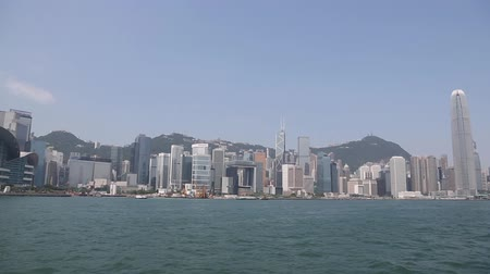 kerület : HONG KONG  CIRCA JUNE 2014: Panorama of the central districts Hong Kong modern highrise buildings from Victoria Strait. In the strait of very heavy traffic of ferries cruise ships and ocean liners