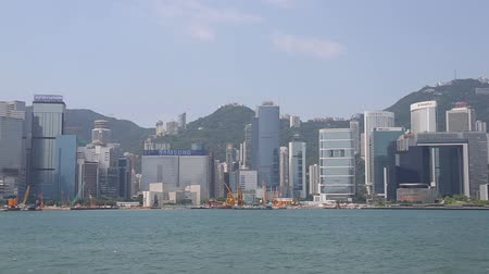 centrální čtvrť : HONG KONG  CIRCA JUNE 2014: Panorama of the central districts Hong Kong modern highrise buildings from Victoria Strait. In the strait of very heavy traffic of ferries cruise ships and ocean liners