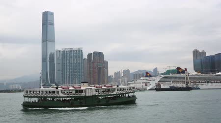 icc : HONG KONG CIRCA JUNE 2014: View of the Kowloon Peninsula the International Commerce Centre ICC and Harbour CityOcean Terminal. Cruise ship runs on the Victoria Harbour.