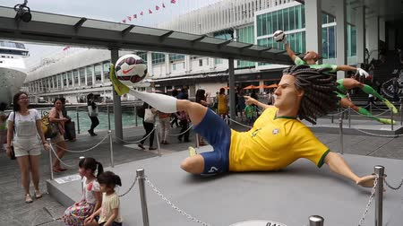 hong kong foot : HONG KONG CIRCA JUNE 2014: Sculptures of world football stars at Nike installation Gigantic quotThe Last Gamequot Football Figures. Mega sized four meter tall figures of football stars in Harbour City