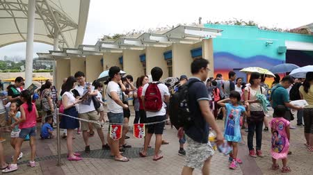 kuyruk : HONG KONG CIRCA JUNE 2014: Visitors to the Ocean Park Hong Kong before opening. There is a marine mammal park oceanarium animal theme park and amusement park in the Ocean Park.