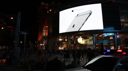billboards : BEIJING - CIRCA JUNE, 2015: Banner at the Apple store advertising smartphone Apple iPhone 6 in Wangfujing shopping area. Wangfujing street is located in the city center and is popular with tourists.