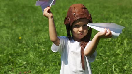 sen : Boy in the old helmet pilot playing with paper plane