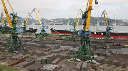 importação : NAKHODKA, RUSSIA - CIRCA SEPTEMBER, 2015: Moorings for processing metal at the port of Nakhodka. It is the largest port in Russia, the main export goods in port of Nakhodka are coal, oil and metals