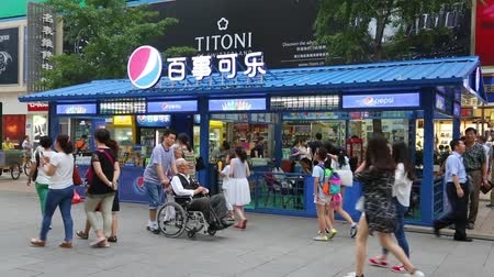 pepsico : BEIJING - CIRCA JUNE , 2015: Pepsi Cola Trading pavilion on Wangfujing Street.  Pepsi - non-alcoholic soft drink sold worldwide. Rights to the trademark Pepsi-Cola owned by American company PepsiCo Stock Footage