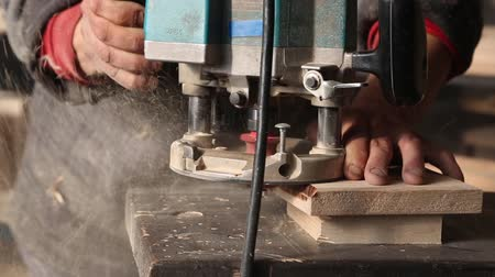 velo : Joiner handles the wood element manual milling machine in workshop Stock Footage