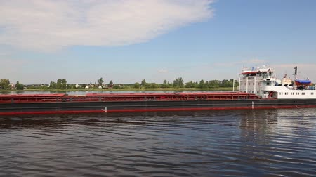 VOLGA RIVER, RUSSIA - CIRCA JUNE, 2016: Dry cargo ship goes on the river Volga in the summer navigation.