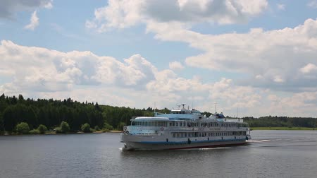 VOLGA RIVER, RUSSIA - CIRCA JUNE, 2016: Passenger cruise ship moves along the famous Volga river in the summer navigation.