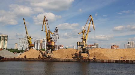 MOSCOW, RUSSIA - CIRCA JUNE, 2016: Port berths with cranes on the banks of the Moskva River in Moscow. Handling of goods through the ports of Moscow is of great economic importance to the business