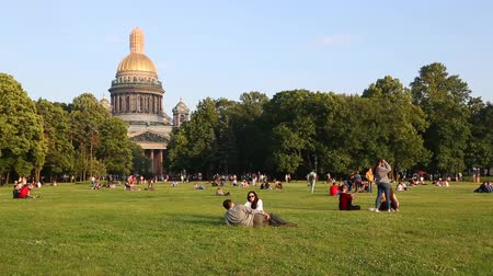ST. PETERBURG, RUSSIA - CIRCA JUNE, 2016: People relax on the lawn in the Alexander Park in St. Petersburg. This is one of the favorite places of the townspeople and guests visiting the city.