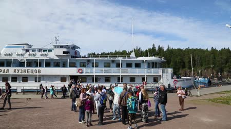 VALAAM ISLAND, RUSSIA - CIRCA JUNE, 2016: Tourists from the ship on the quay of the island of Valaam - popular tourist destination. Island is a monument of Russian architecture - the Valaam Monastery