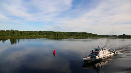 SVIR RIVER, RUSSIA - CIRCA JUNE, 2016: Passenger motor boat moves on the river Svir. Svir River connecting Ladoga and Onega lakes in the north of Russia.