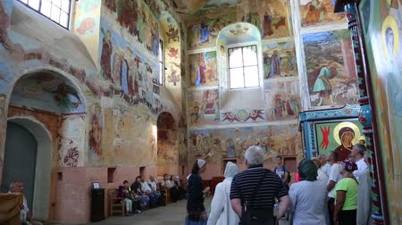LENINGRAD REGION, RUSSIA - CIRCA JUNE, 2016: Tourists visiting the interior of the wall paintings of the Trinity Cathedral of the Holy Trinity Alexander Svirsky male monastery in Lodeinopolsky area.
