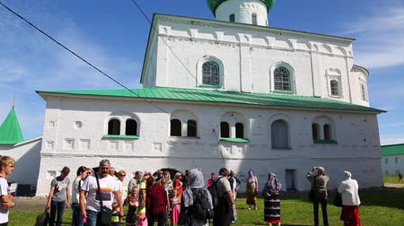 murals : LENINGRAD REGION, RUSSIA - CIRCA JUNE, 2016: Tourists on the tour at the Trinity Cathedral in the famous Holy Trinity Alexander Svirsky male monastery in Lodeinopolsky area.