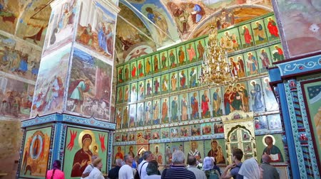 sobor : LENINGRAD REGION, RUSSIA - CIRCA JUNE, 2016: Tourists visiting the interior of the wall paintings of the Trinity Cathedral of the Holy Trinity Alexander Svirsky male monastery in Lodeinopolsky area.