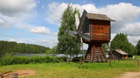 reconstructed : Old restored windmill on the shore of the Svir River museum and the tourist village of Upper Mandrogi. Karelia, north of Russia.